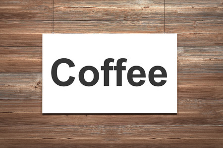 white canvas hanging on wooden wall coffee photo