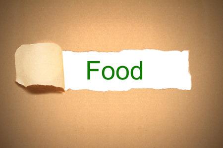 reveal: brown packaging paper torn to reveal food