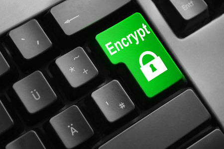 personal data privacy issues: dark grey keyboard green enter button encrypt lock symbol Stock Photo