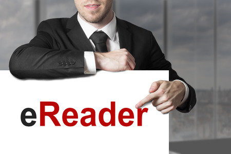 ereader: businessman in office pointing on sign ereader Stock Photo