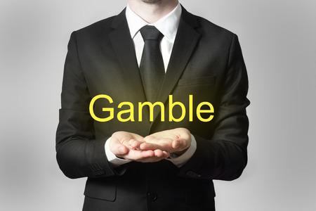 gamble: businessman in black suit begging gesture gamble