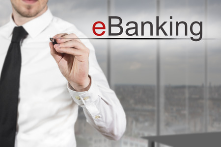 international bank account number: businessman in office writing eBanking in the air