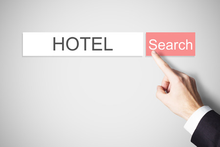 cancellation: businessmans finger pressing red search button hotel webbrowser Stock Photo