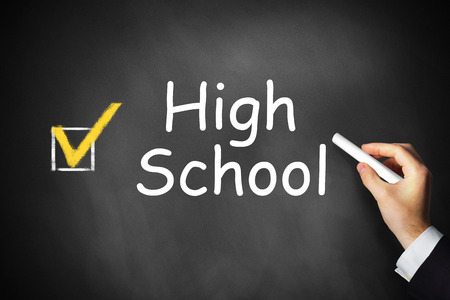 highschool: hand writing highschool on black chalkboard checkbox