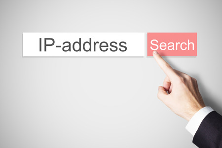 vpn: businessman finger pressing red search button ip address