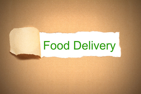brown package paper carton torn to reveal white space food delivery photo