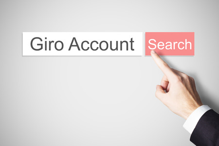 international bank account number: businessmans finger pushing red webbrowser search button giro account
