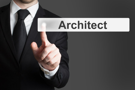 businessman in black suit pushing button architect photo