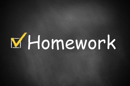 outwork: checkbox checked homework on black chalkboard
