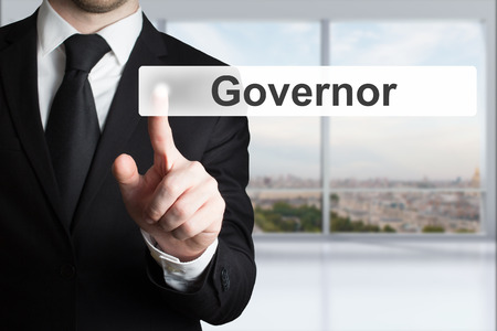 governor: businessman in office pushing flat button governor