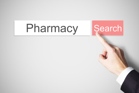 hospital expenses: finger pushing red websearch button pharmacy Stock Photo