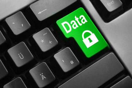 personal data privacy issues: grey keyboard with green enter button data security lock Stock Photo