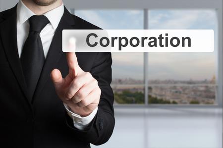 businessman in black suit pushing flat touchscreen  button corporation Standard-Bild