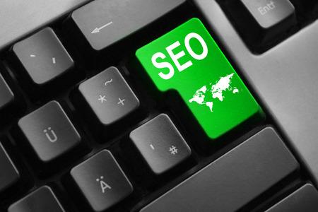 web crawler: dark grey keyboard green enter button seo search engine
