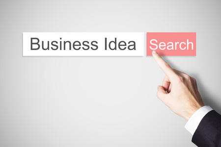 browser business: finger pushing red web search button business idea browser Stock Photo