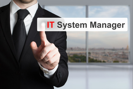 businessman in office pushing touchscreen button it system manager