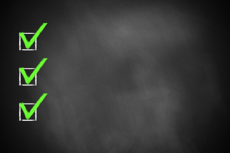 checkboxes: three green marked checkboxes on a black chalkboard