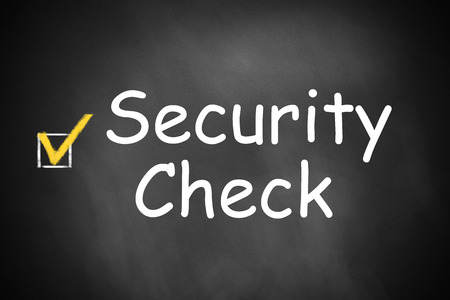 security check: black chalkboard with checkbox checked security check