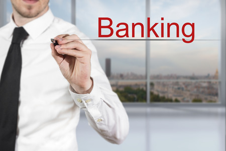international bank account number: businessman in office writing banking in the air