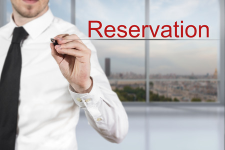 proved: businessman in office room writing reservation in the air Stock Photo
