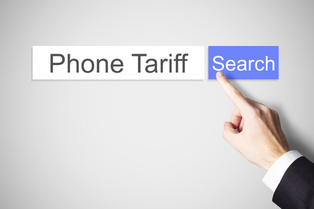 tariff: finger pushing blue web search button phone tariff Stock Photo