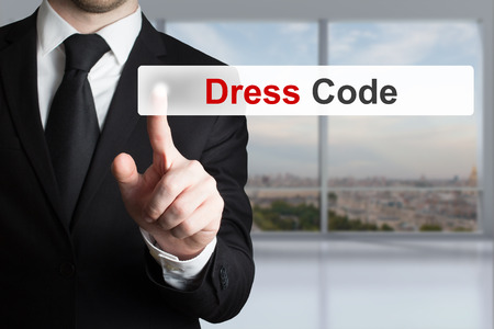 businessman in office pushing touchscreen button dress code