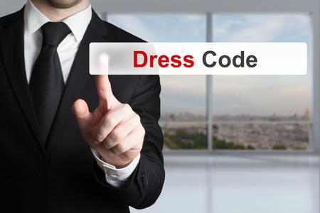 businessman in office pushing touchscreen button dress code