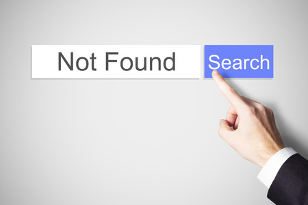 connect: finger pushing blue search button not found internet Stock Photo