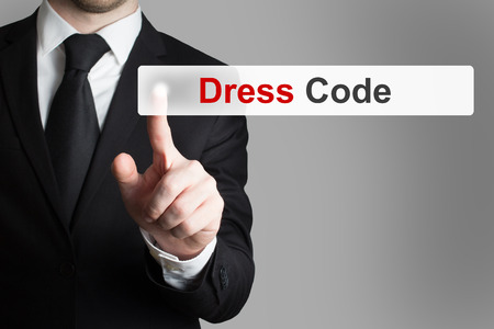 dress code: businessman in office pushing touchscreen button dress code