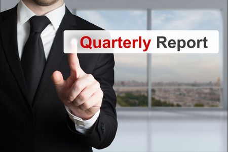 quarterly: businessman in office pushing button quarterly report