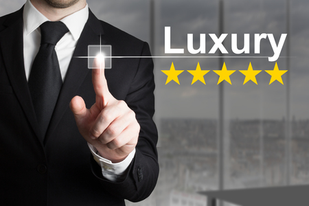 five stars: businessman pushing flat button luxury five golden stars rating Stock Photo