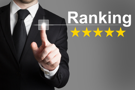 five stars: businessman in suite pushing button ranking five rating stars