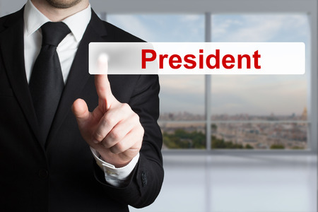 minister of war: businessman in black suit pushing flat button president