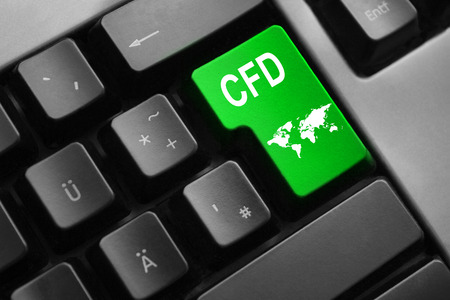 indebtedness: grey keyboard with green enter key cfd international trading Stock Photo