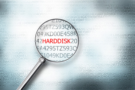 cyberwar: magnifier searching the word harddisk on computer screen 3d illustration
