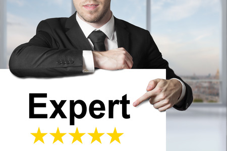 businessman in black suit pointing on sign expert five star rating