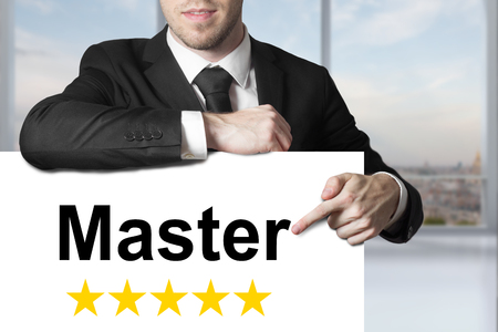 proved: businessman in suit pointing on sign master gold stars Stock Photo