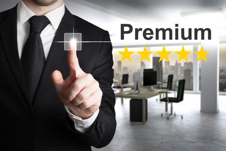 pushing button: businessman in black suit pushing button premium golden rating stars Stock Photo