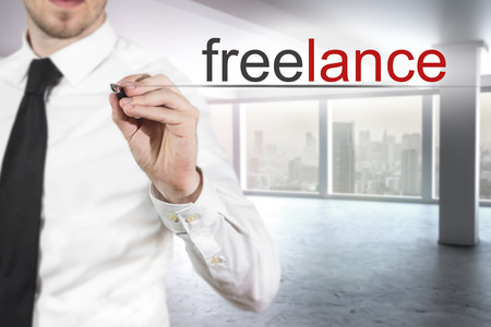 large office: businessman in modern large office writing freelance in the air Stock Photo