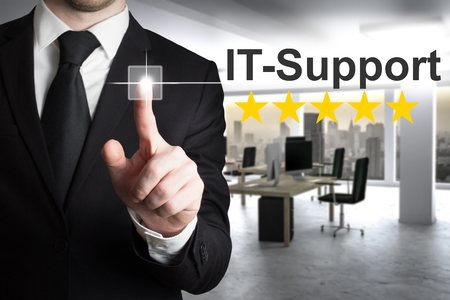 five star: businessman pushing touchscreen button it support in modern office