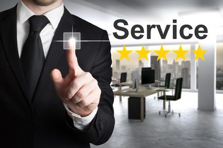 five stars: businessman in office pushing button service five stars