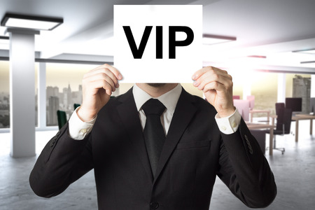 privileged: businessman prominence hiding face behind white sign vip