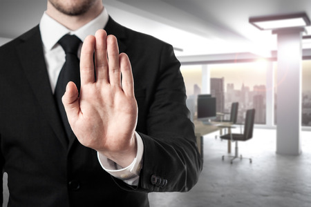 limitations: businessman in modern office room hand stop gesture Stock Photo
