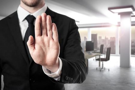businessman in modern office room hand stop gesture Standard-Bild