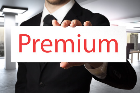 proved: businessman in modern office holding sign premium