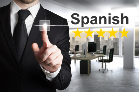 businessman in office pushing button spanish 版權商用圖片