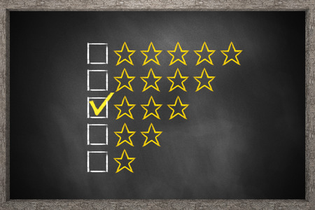 comparing: golden rating three stars black chalkboard 3D Illustration