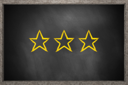 critique: three gold stars black chalkboard 3D Illustration Stock Photo