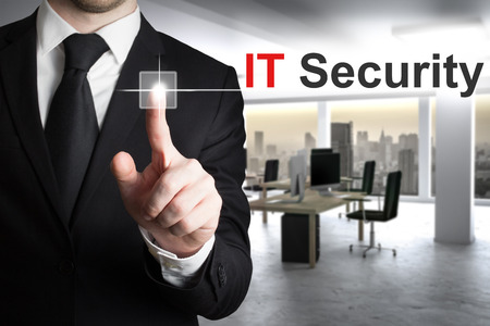 businessman in office pushing button it security Stock Photo