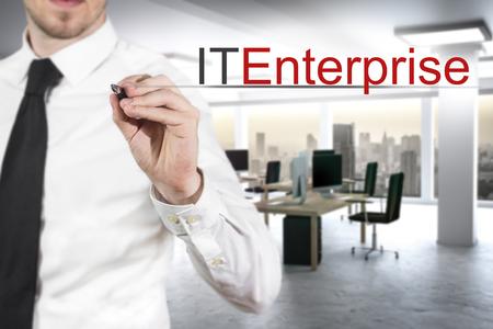 brute: businessman in large modern office writing it enterprise
